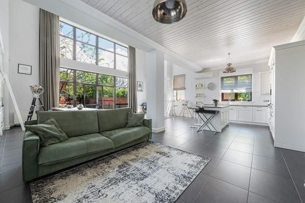 Hoe creëer je rust tussen woonkamer en keuken?